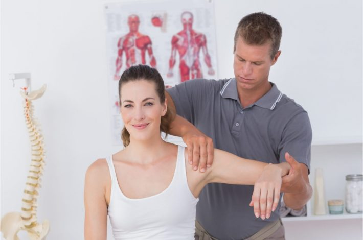 male examining womans muscle