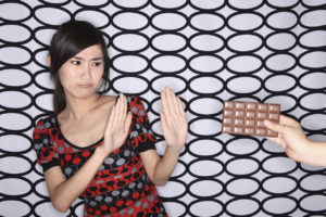 Woman-refraining-from-eating-chocolate