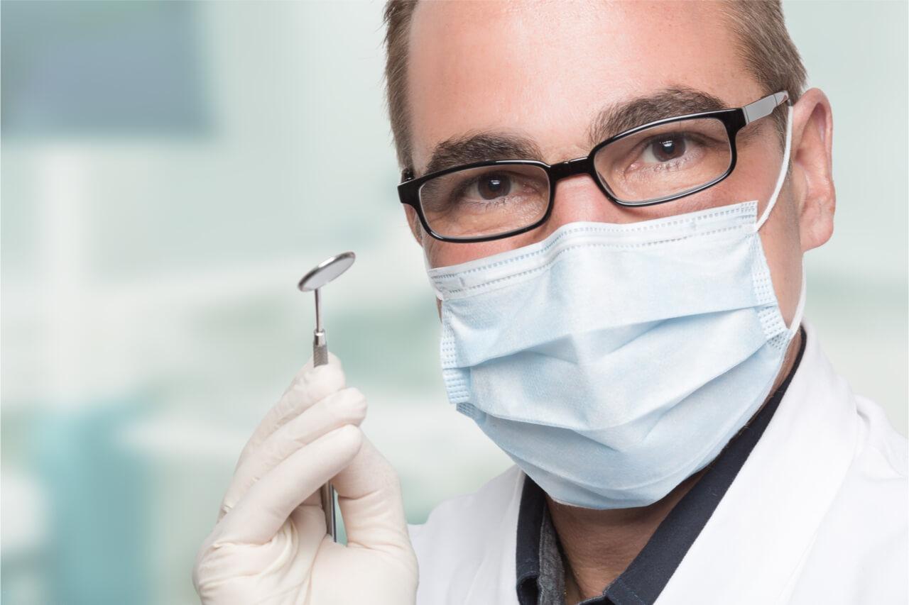The dentist gives instructions for proper dental hygiene.
