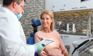 The dentist explains the different treatments for missing teeth.
